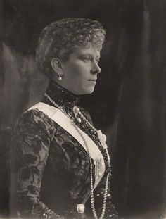 Mary, The Duchess of York wearing a dark mourning dress. The white sash is the order of Victoria and Albert, First class, worn on riband (an unusal practice) Melbourne, 9 May 1901