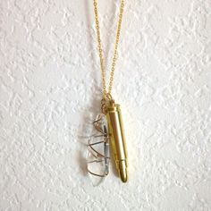 """Pipe Necklace. Gold Bullet Charm doubles as a working smoking pipe. Large wire-wrapped crystal, 30"""" gold plated chain. For tobacco use, 18+ only."""