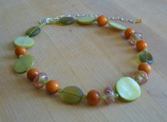 Orange and Green Lampwork Glass, Tagua Nut and Shell Necklace by The Gussied Bead