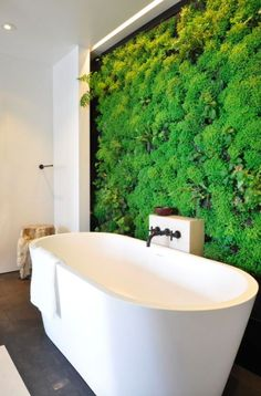 Indoor plant wall in a modern bathroom, a great way to add Pantone's colour of 2017, Greenery to your home