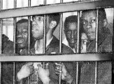 """The Friendship Nine is the name given to a group of college students who served as pioneers for the lunch counter sit-ins in protest against discrimination. Their motto was """"Jail, No Bail,"""" which set a national precedent for demonstrators to choose lockup instead of bailing out to demand justice. The motto became a trend all over the nation during the civil rights movement"""