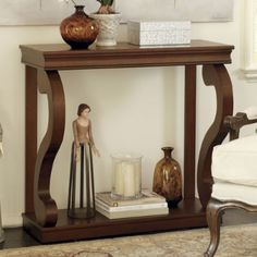 """For the Family room. 36"""" width, wrong finish/color and no draws but I like the scroll design."""