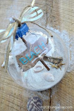 Tutorial for a beautiful DIY beach themed Christmas ornament and a link to many other creative Chris Beach Christmas Ornaments, Coastal Christmas, Christmas Crafts, Christmas Decorations, Wedding Decorations, Christmas Tree, Wedding Ideas, Wedding Pictures, Christmas Ideas