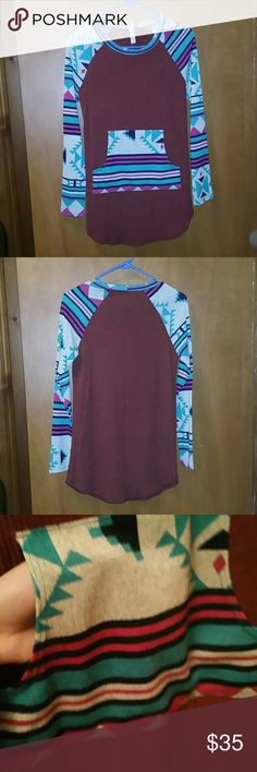 burgundy top Cute aztec burgundy top, has front pockets  96%polyester 4%spandex Tops Tees - Long Sleeve