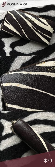 """RARE Kate Spade Cobble Hill Zebra Lacey Wallet Kate Spade Cobble Hill Zebra Lacey Leather Wallet in coconut/cream. Small exterior flaws, please refer to photos and ask any questions before purchasing. Interior is clean and free of ink marks, etc. Very roomy interior with tons of card slots and additional zippered pocket inside. Width 7.75"""", height 4"""", depth 2"""". Pebbled cowhide leather. Rare print/limited edition. kate spade Bags Wallets"""
