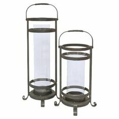 """Crafted of metal and showcasing glass hurricanes, this handsome candle lantern set adds an antique-inspired touch to your credenza or mantel.    Product: Small and large candle lanternConstruction Material: Metal and glassColor: GrayAccommodates: (1) Candle each - not includedDimensions: Small: 20"""" H x 11"""" DiameterLarge: 27"""" H x 11"""" Diameter"""