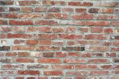Fotobehang baksteen muur via STIJLIDEE Interieuradvies en Styling via www.stijlidee.nl