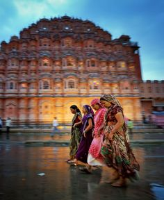 I sat and waited with my camera as people walked by. A nice rainstorm fell and gave the street a reflective and moody feel. I snapped this as the women walked by in front of beautiful Hawa Mahal Palace.