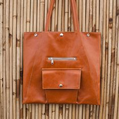 Beautiful vegan bags made in Seattle - it's treated canvas but feels just like leather!