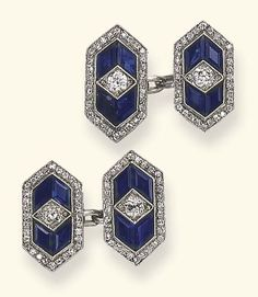 A PAIR OF ART DECO DIAMOND AND SAPPHIRE CUFF LINKS  Each double-link composed of lozenge-shaped plaques, set with calibré-cut sapphires, centering upon an old European-cut diamond, to the single-cut diamond trim, joined by platinum oval-shaped links, mounted in platinum, (one sapphire replaced), circa 1925