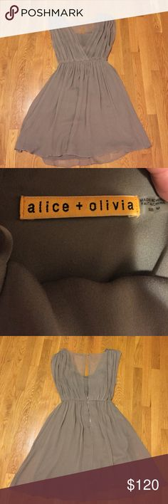 Beautiful ALICE & OLIVIA gray flows dress In excellent condition minus one small stain - completely in- noticeable - as shown in picture Alice + Olivia Dresses