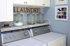 like the shelf to utilize that drop/space behind/over a top load washer.  How cute to put glass jar with spout for liquid detergent!!!