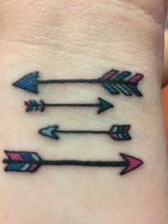 Family Arrow Tattoo. Father and Mother on the outside. Small arrows are our boys. We all share the same colors of arrow feathers because no matter what direction we go in life we'll always be together as a family.