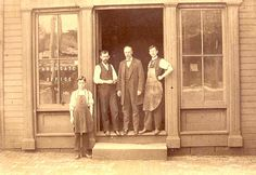 A group of men in front of the office of the Advocate Newspaper in Dover, Ohio.