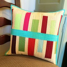 """Lots of inspiration -- cute pillows made by bloggers using patterns from """"Think Big: Quilts, Runners, and Pillows from 18"""" Blocks"""" by Amy Ellis."""