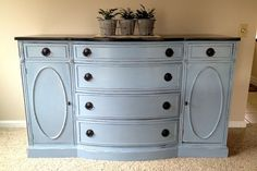 ASCP Louis Blue. hardware was spray painted with Krylon Oil Rubbed Bronze. The great thing about Annie Sloan Chalk Paint is that it the furniture does not have to be primed before you start painting. I wanted a little bit of white showing after I distressed the buffet, so I did prime this piece before I started painting.I sanded the top and took off all the original stain. Top - Minwax in Ebony + three coats of polyurethane.