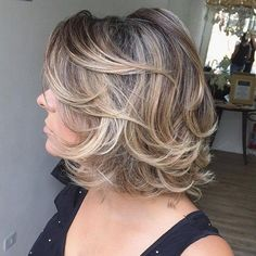 Medium Curly Layered Hairstyle | Get great fashion tips at 40plusstyle.com