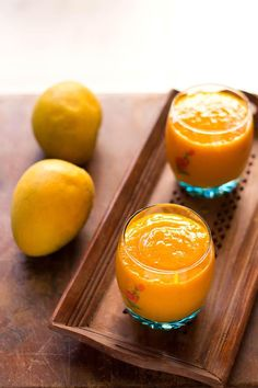 in this mango banana papaya smoothie recipe, you will taste a bit of all three fruits and it is on sweeter side. smoothies is a sweet way to include fruits in your diet. Mango Smoothie Healthy, Tropical Smoothie Recipes, Papaya Recipes, Papaya Smoothie, Banana Dessert Recipes, Easy Smoothie Recipes, Yummy Smoothies, Smoothie Drinks, Fruit Recipes