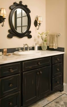 I love this but I'd replace the sink with a square/rectangle one and the mirror to match....bathroom cabinet- I am so repainting ours!