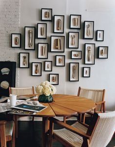 Love this unique dining room table and art wall!