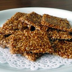 Sesame Seed Snaps: Easy to make in the microwave, these sesame seed snaps made with organic sesame seeds and unpasturized liquid honey are a sweet treat with some nutrition too. Delicious Snacks, Healthy Snacks, Healthy Eating, Healthy Recipes, Homemade Candies, Homemade Food, Asian Foods, Asian Recipes, Muesli