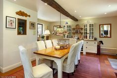Attractive: The Quaives also features a three-bedroom outhouse, two separate cottages and a tennis court. Above, a smaller dining room
