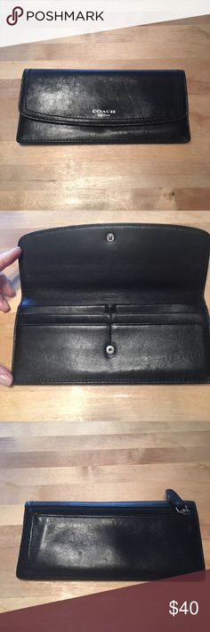 COACH Black Leather Wallet - COACH Black Leather Wallet    - Black leather wallet with silver detail. Flap closure with card pockets and open bill pocket.    - 100% guaranteed authentic coach wallet   - Excellent used condition 9/10 rating. No significant signs of wear anywhere on item. No tears, stains, scuffs, or tarnishing on metal. Coach Bags Wallets