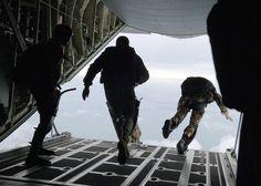 US Navy SEALS leaving a plane the hard way, via Flickr.