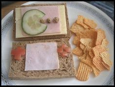 I made my son Nintendo DS sandwich for lunch today. Cucumber pacman on the turkey screen. He was so happy.