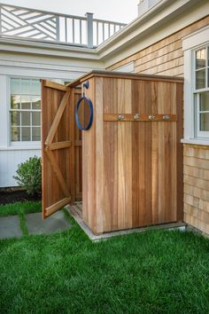 outdoor shower with hooks retro fit a storage unit to be a shower house.