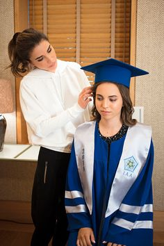 Queen Rania of Jordan (L) is pictured during the graduation ceremony of Princess Salma (R) from the International Academy on May 22, 2018, at Amman, Jordan.