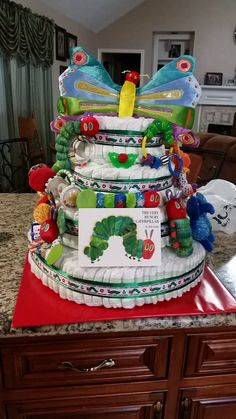 The Very Hungry Caterpillar Diaper Cake this is pretty bizarre and extremely expensive but look at all those caterpillar toys!!!