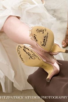 Bridesmaids sign wedding shoes- DARN! I wish I would have thought of this. But then again, I still wear my wedding shoes because I love them so much :)