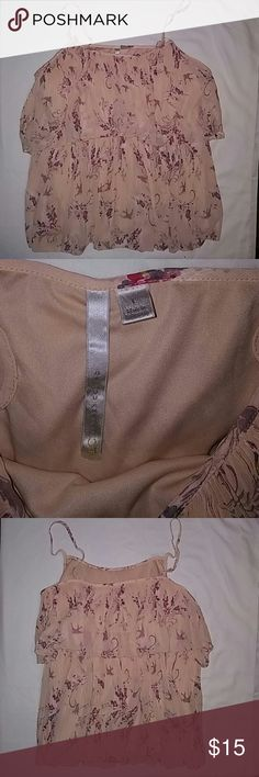 Women's Lauren Conrad size Large Top Adjustable spaghetti straps. Peach colored with flowery pattern. Sheer outter shell 100% polyester, lining 100% polyester. Very cute top by Lauren Conrad. Excellent condition. LC Lauren Conrad Tops Camisoles