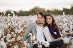 Engagement photo tip: To give your shots a sense of place, take pictures in a field growing a local crop (this Southern couple chose cotton; as a Michigander, I'd probably end up in a cherry orchard)   Photography credit: Chris Isham