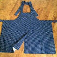 Pottery Apron!  I need to make some of these,  The split and overlap would be perfect.