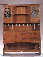 Oak sideboard attributed to E A Taylor for Wylie & Lochhead. Circa 1900.