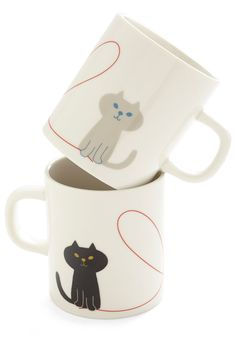 Thoughtful Pals Mug Set. Exchange a cup of coffee for the thankful smile of your pal when you greet her with this ceramic ivory mug bearing a gift-toting kitty. #multi #wedding #modcloth