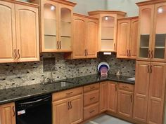 Kitchen Backsplash With Oak Cabinets countertop/back splash: combination of dark quartz countertop