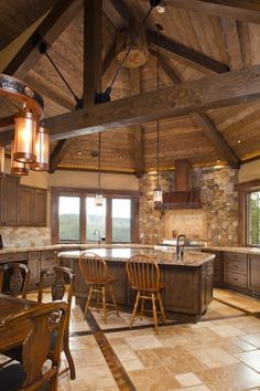 Gorgeous. Love this warm and inviting kitchen. I don't like the choice of bar chairs and dining set though. Would look better with a buttery cream coloured leather bar stools and chairs.