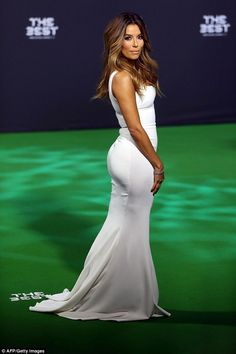 White hot:Eva Longoria kicked and scored at the annual the Best FIFA Football Awards in a sizzling white gown inZurich, Switzerland, on Monday