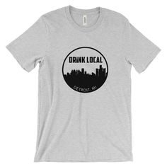 Detroit, MI Drink Local Skyline Unisex T-shirt (Light)  Be proud. You live in a city with Lions, Tigers, and Beers. This super-soft, baby-knit t-shirt looks great on both men and women – it fits like a well-loved favorite. Made from 100% cotton, except for heather colors, which contain polyester.  • 100% ring-spun cotton (heather colors contain polyester) • Baby-knit jersey  • Shoulder-to-shoulder taping  • Cover stitched and hemmed sleeves  • Side-seamed