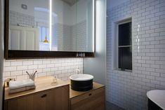 Kombinat designs kitchen-style workplace for Vienna apartment