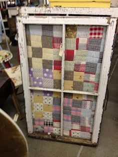 An Old Window Frame...becomes a primitive home decor piece with the addition of an old piece of quilt in the frame.