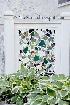 mosaic screen to hide air conditioner, diy home crafts, outdoor living, Cracked and smashed China pieces of mirror and stained glass hide an...
