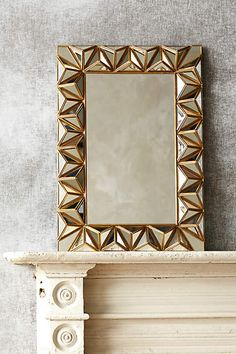 Anthropologie EU Studded Pyramid Mirror. Three-dimensional, geometric prisms outline your reflection with this handmade mirror. A vision of modern bohemia, it's just the thing to top off your mantle.