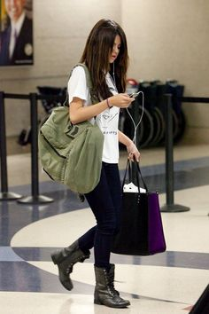 Selena Gomez arriving at LAX wearing chic combat boots