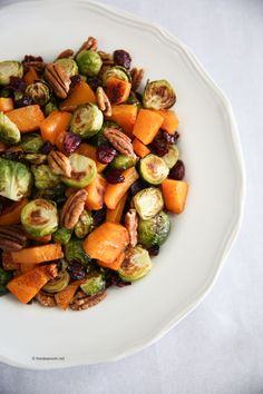 I halved the recipe, roasting the squash and brussel sprouts in one pan, and used Olive Oil spray for the parchment paper instead of Olive Oil. It was a hit with the family, so I'll make it again (I halved the pecans, so next time I'll use pecan pieces instead of whole pecans.)