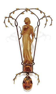 GOLD, IVORY AND CITRINE QUARTZ PENDANT, RENÉ LALIQUE, CIRCA 1900. Designed as a carved ivory maiden standing within a trellis of scrolling branches bearing  yellow enameled buds, upon a base of a rectangular citrine suspending a citrine drop, signed Lalique.