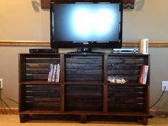 TV stand made from crates. Matches the coffee table